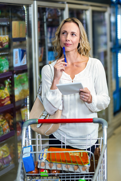 Thoughtful woman at the supermarket