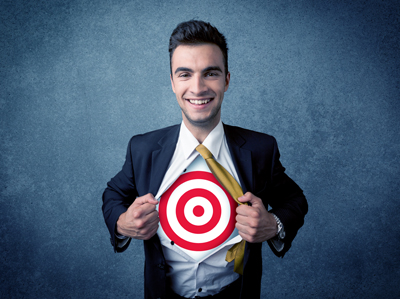 Businessman tearing shirt with target sign on his chest