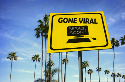 aged and worn vintage photo of gone viral sign at beach with pal