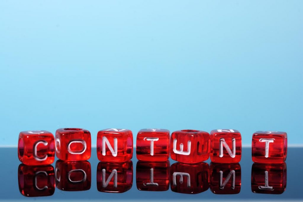 Content written  on red cubes on blue  background